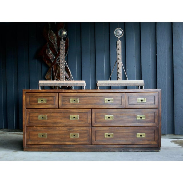 Classic campaign style dresser with brass pulls. The drawers are constructed with dovetail joinery; piece is made...