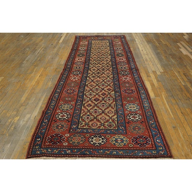 Antique NW Persian Rug with a yellow background.