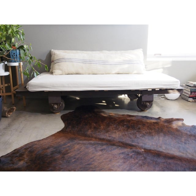 This is an authentic 20th-century cast iron railroad cart that we transformed into a couch/daybed/bed. The railroad is...