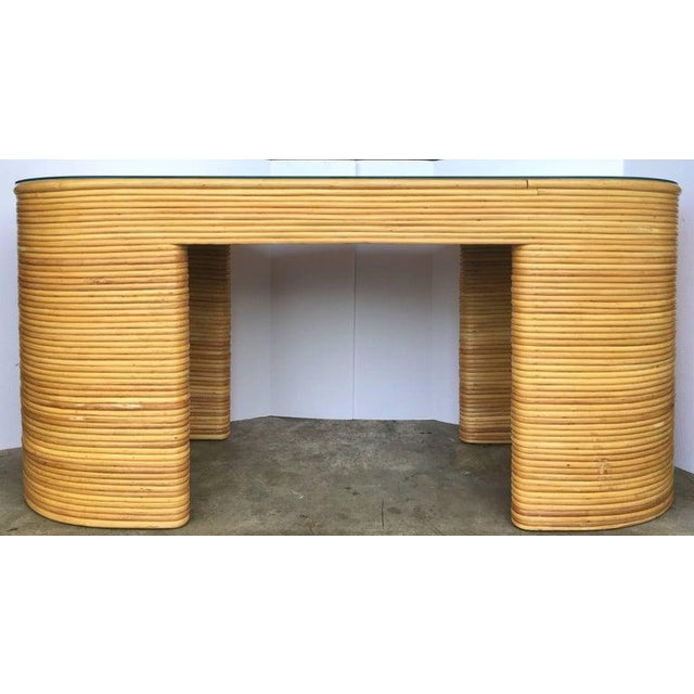 Unique Mid-Century Modern stacked rattan wicker desk in the style of Paul Frankl. This Palm Regency style large curved...