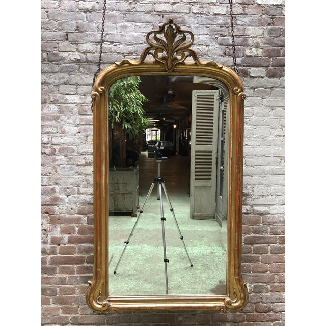 Exceptional art nouveau mirror with is original bevelled mirror glass. Gold leaf gilded . From a private collection in...