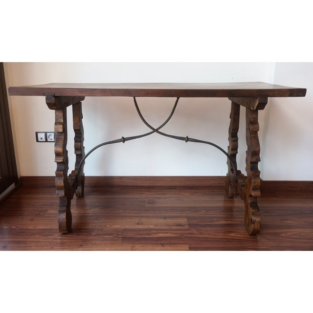 18th century Catalonian dining table with Baroque style lyre legs This Spanish 18th century table features a rectangular...