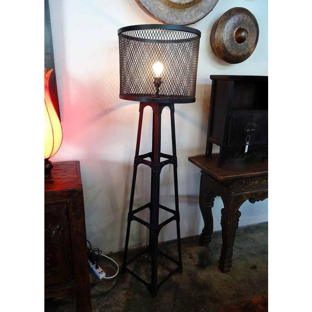 Iron mesh floor lamp. Heavy duty iron frame with studs and an iron mesh barrel lamp shade. This lamp looks great in...