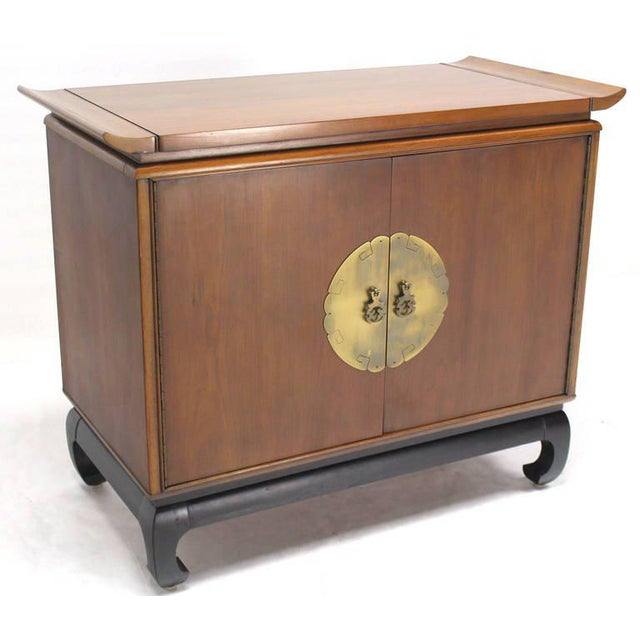 Very nice mid-century modern walnut cabinet with beautiful brass hardware on black ebonised base.