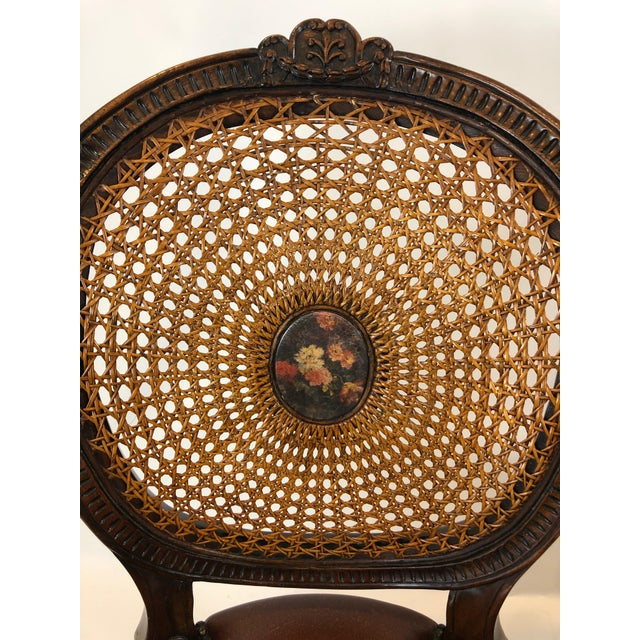A grand Theodore Alexander cameo caned back armchair having beautiful decorative floral center medallion and rich brown...