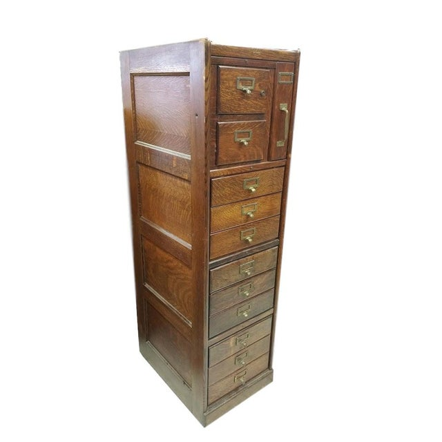 Antique File Cabinet with great Drawers and storage by Macey's. It has 12 drawers ranging in sizes. It is in excellent...