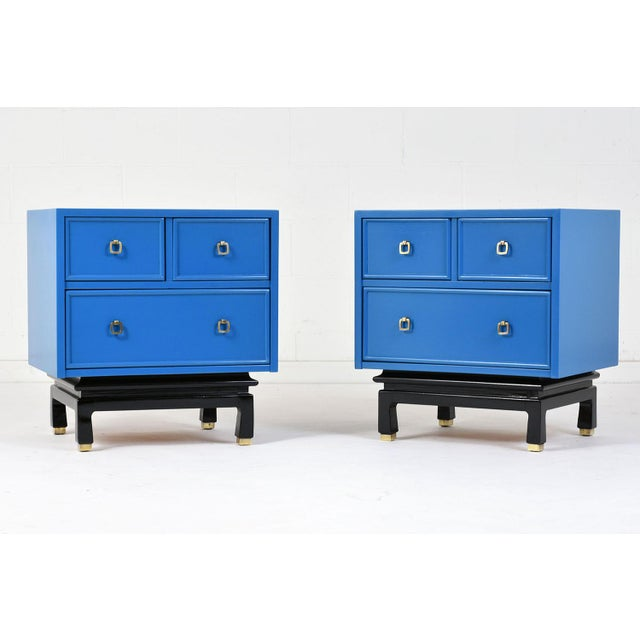 This pair of 1960's Mid-Century Modern-style chest of drawers is made by American of Martinsville. The chests of drawers...