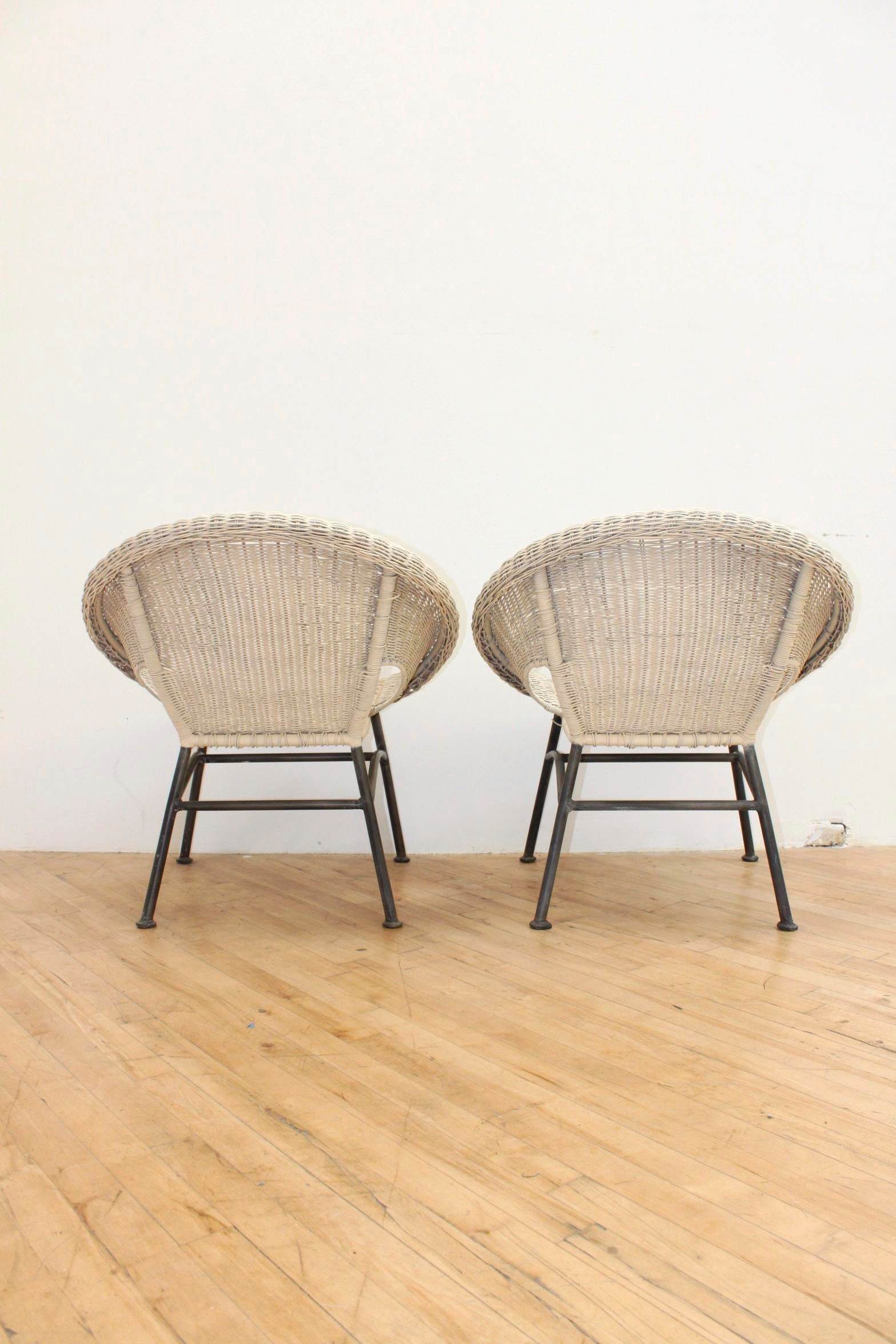 Merveilleux Industrial Mid Century Modern Wicker And Iron Stacking Saucer Chairs   A  Pair For Sale