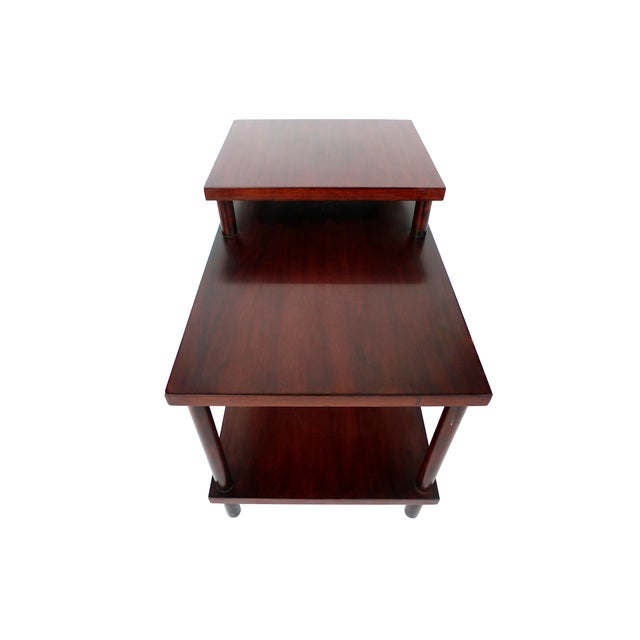 This lacquered side table was designed by T.H. Robsjohn-Gibbings for Widdicomb. It has a beautiful dark-red finish. Its...
