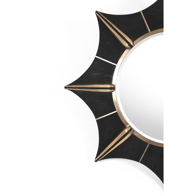 The star mirror in black shagreen and bronze-patina brass details is a celestial inspired piece that gives a dramatic...
