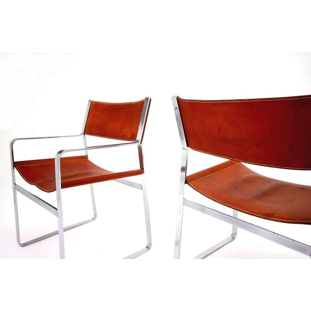 Rare pair of JH-813 armchairs by Hans J. Wegner with frames of flat steel and original hand-stitched saddle leather....