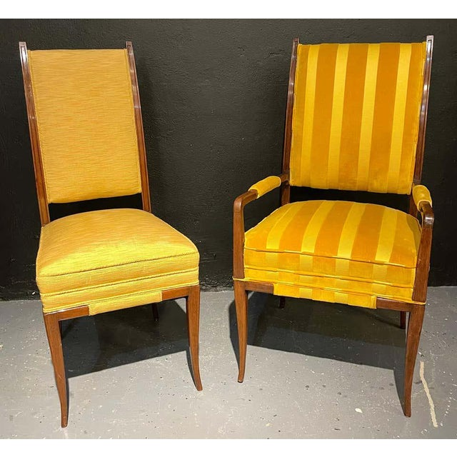 Six Parzinger dining chairs each having high backs and strong frames in the original fabric. A pair of arms and four sides...