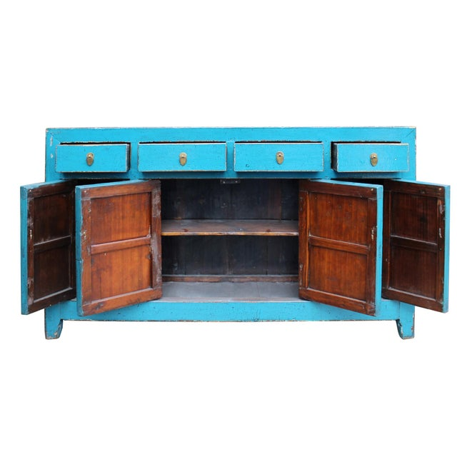 This is a sideboard cabinet table with four drawers and two compartments. It is finished with rustic distressed blue color...