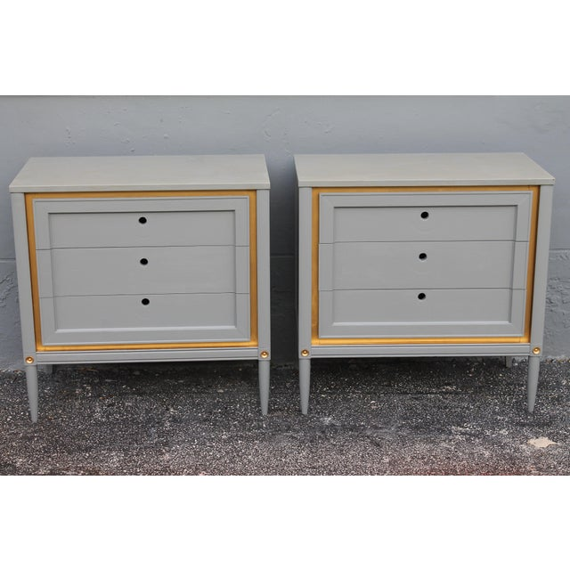 A stunning pair of 1960's slate blue with gold embellishment designer finished bachelor's chests or large nightstands....