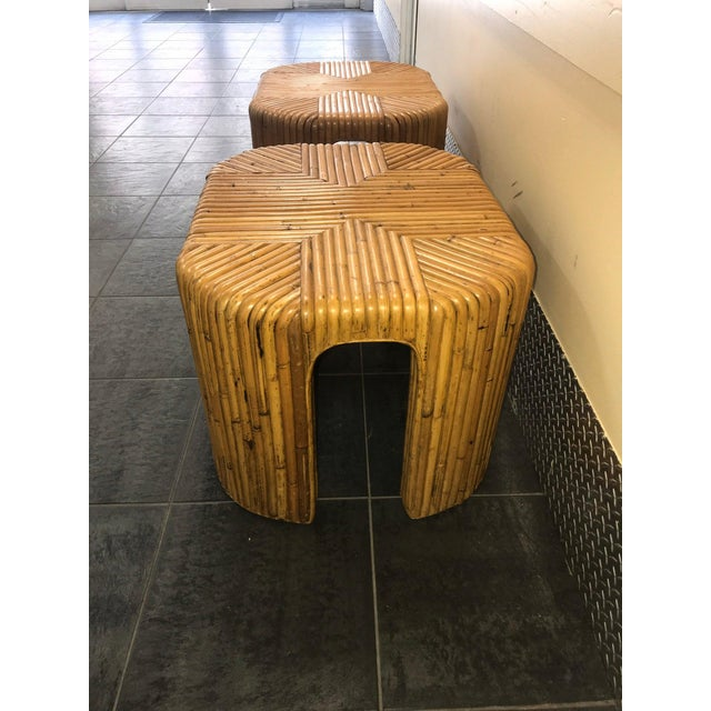 This is an awesome pair of split reed end tables. They are done in the style of Gabriella Crespi. The shape is a round...