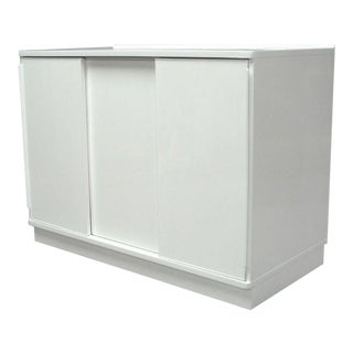 A White Lacquered Sliding Door Cabinet by Edward Wormley For Sale