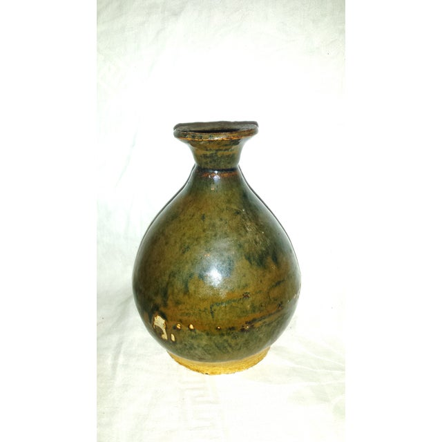 This beautiful, antique vase features a rich caramel glaze with gorgeous patinated colors of grey and greens. Unglazed...