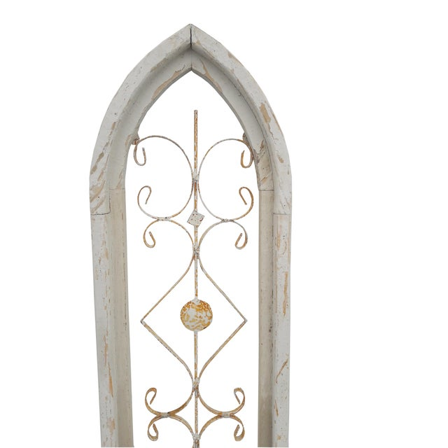 Pair of cathedral pointed window frames made from reclaimed wood, with scrolled metal inserts; antique white distressed...