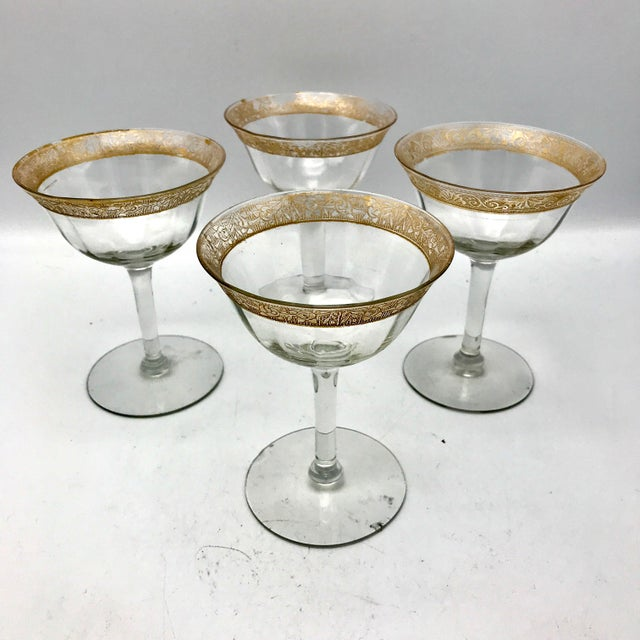 This set of 4 Tiffin glasses in the gold encrusted optic panel Minton pattern is just lovely. the 24k gold band on the rim...