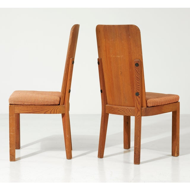 """A pair of """"Lovo"""" chairs designed by Axel Einar Hjorth for Nordiska Kompaniet, Sweden, circa 1930s. Solid pine with black..."""