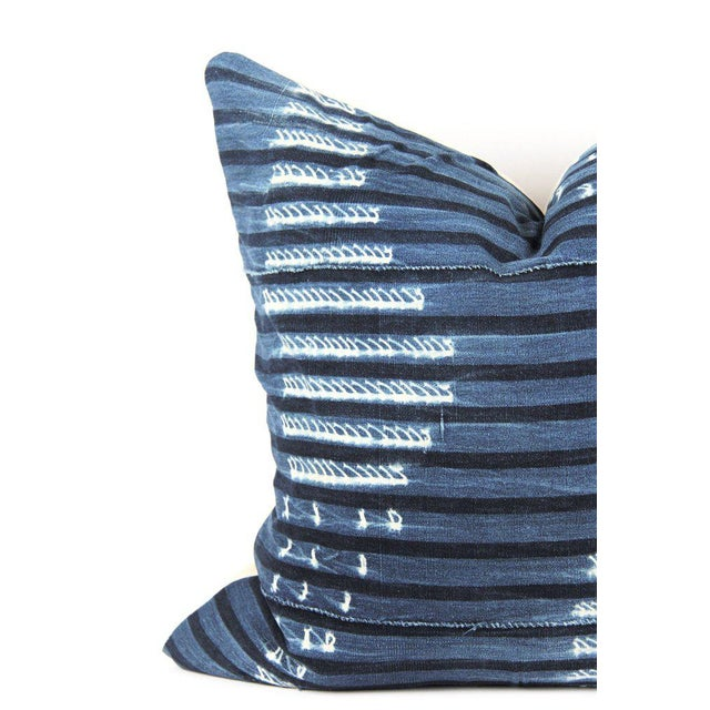 Hand crafted pillow featuring a beautiful, vintage indigo African mud cloth textile with abstract white stripe pattern....