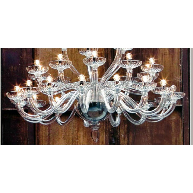 Pure and elegant 3 tier Italian Mid-Century style Venetian glass chandelier in clear glass in a sober, modern traditional...