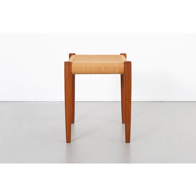 "stool designed by Niels Moller for J.L. Mollers Mobelfabrik Denmark, c 1960s teak + original cord 18 ¼"" h x 19 ½"" w x 14..."