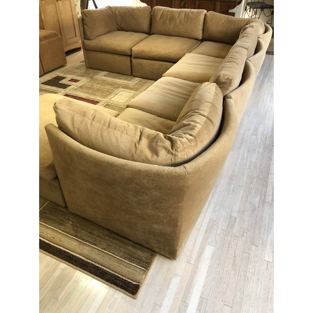 Flexible seven-piece sectional sofa consisting of three corner pieces, three interior pieces and a single ottoman. Each...
