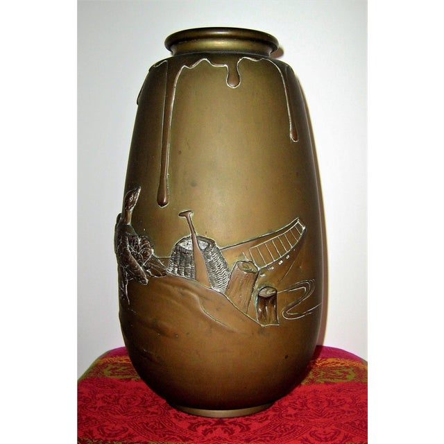Large Japanese Meiji bronze vase in ovoid form with a short, flared neck. This is a heavy, fine quality piece featuring a...