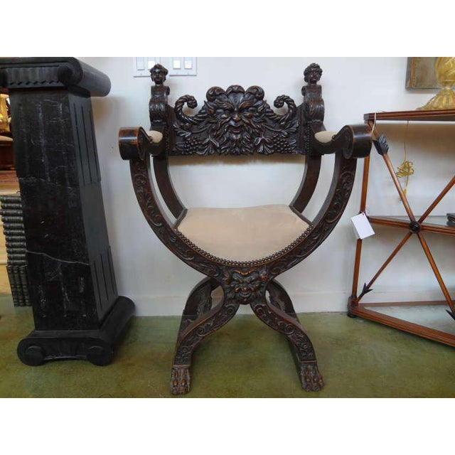 Handsome Antique Continental Renaissance style or Gothic style walnut armchair with fine carving upholstered in suede with...