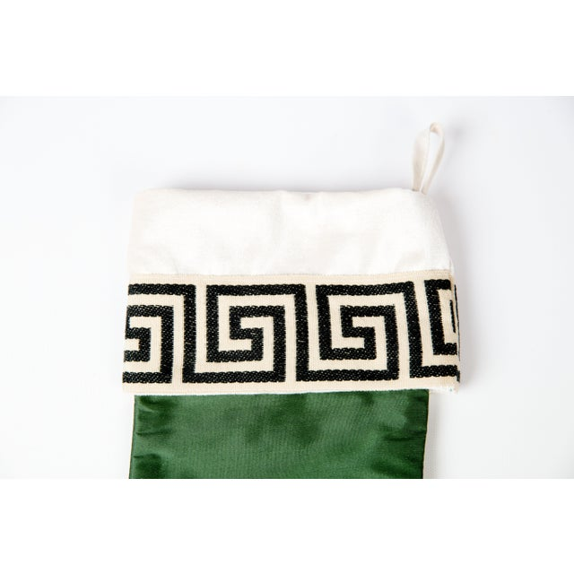 Custom-made emerald green silk stocking with black-and-cream Greek key trim. Trim and silk on both sides. Loop for hanging.