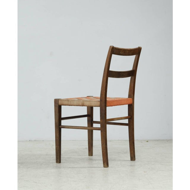 An Axel Larsson chair for Svenska Möbelfabriken, designed in 1929. The chair is made of birch with a mixed beige and...