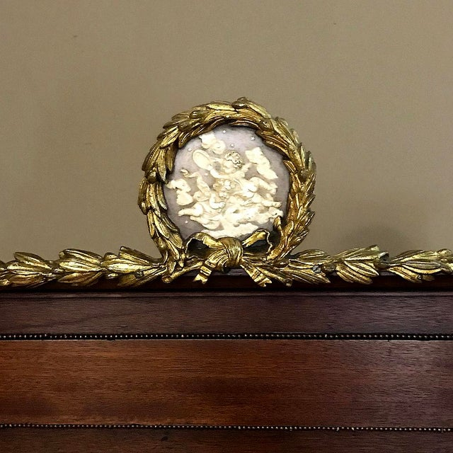 19th Century French Louis XVI Queen Bed with Ormolu Mounts is a spectacular example of the height of artistry from the...
