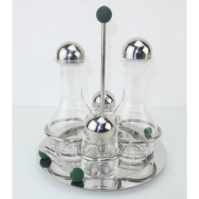 Functional and fabulous! This postmodern stainless steel and glass cruet set from the luxury Italian brand, MEPRA,...