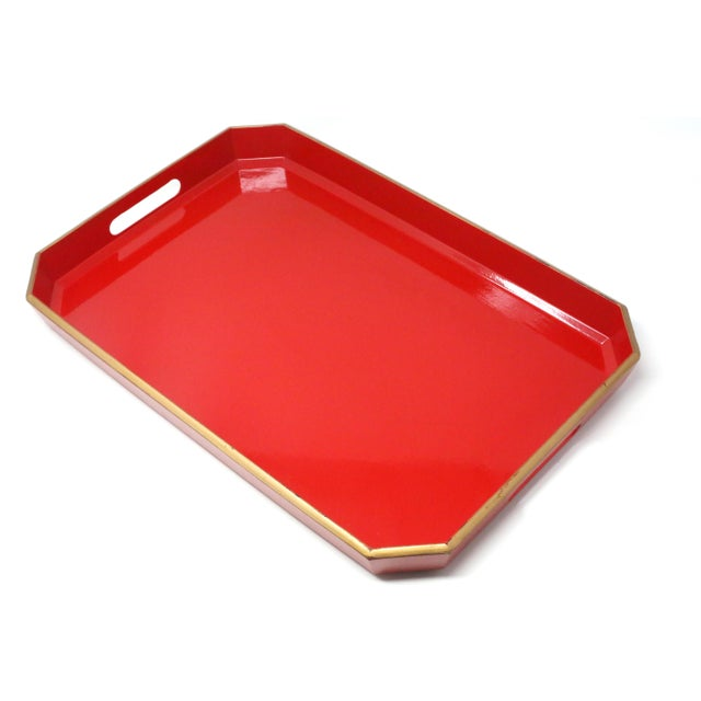 A vintage, melamine serving tray, covered in red lacquer, with gold accent on the rim. Made in Japan.