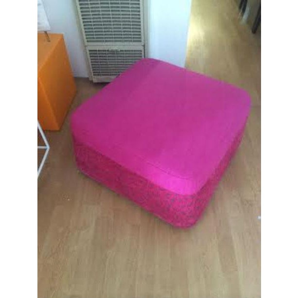 This funky fuchsia ottoman comes straight off the floor of a designer furniture showroom and is ready to serve as a...