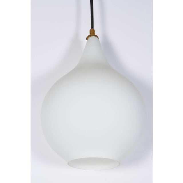 Italian handblown pendant light, circa 1950. Glass shade is layered with a clear satin finished over white in a tear drop...