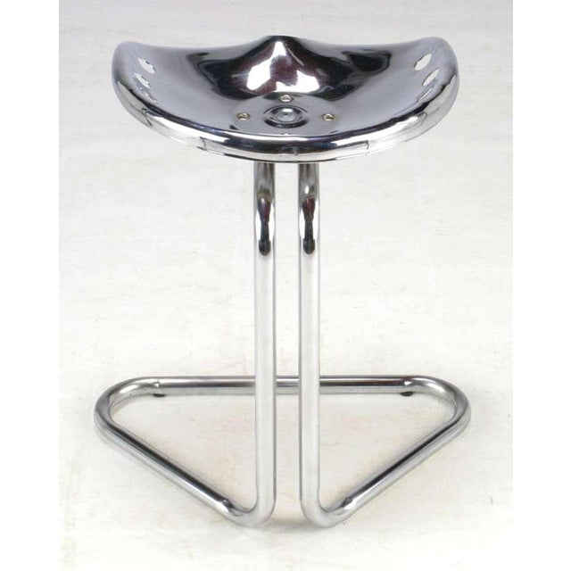 Cantilevered chrome tractor seat inspired by the work of Achille and Pier Giacomo Castiglioni for Zanotta. Similar seat...