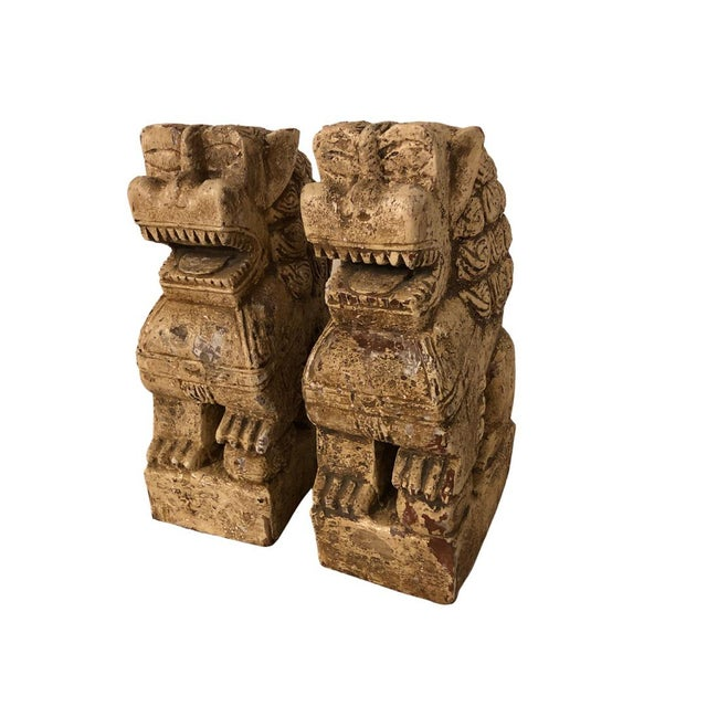 Amazing Foo Dogs. Wood with many layers of paint that are chipping. They were appraised at 100 years old.