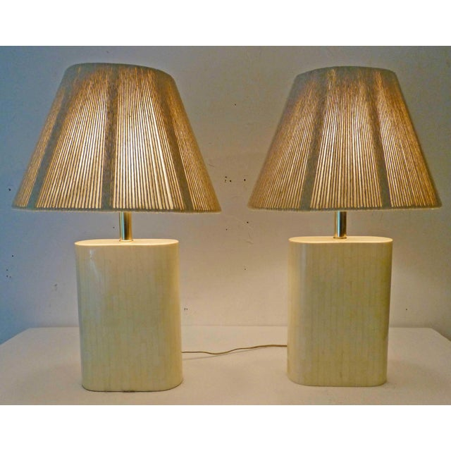 Freshly sourced from a Beverly Hills celebrity estate, is this truly gorgeous pair of Karl Springer lamps in perfect...