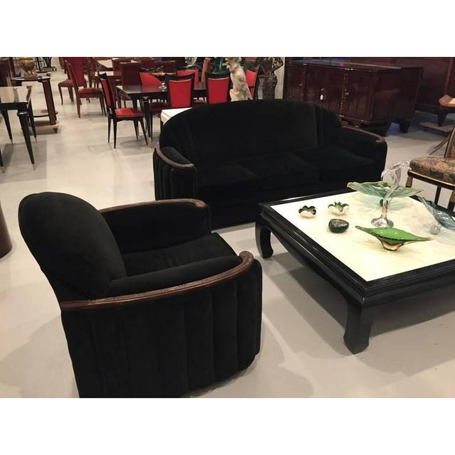 Beautiful American Art Deco sofa and club chair set. Having stunning Deco wood armrests and matching wood feet or legs....