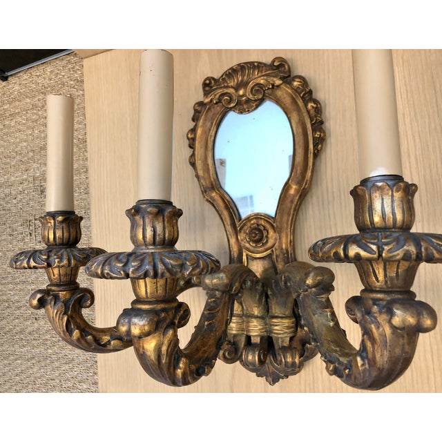 Large Traditional Wood Carved 1920's Vintage Three Arms Antique Gilded Wall Sconces, with Mirror. This wall sconces came...