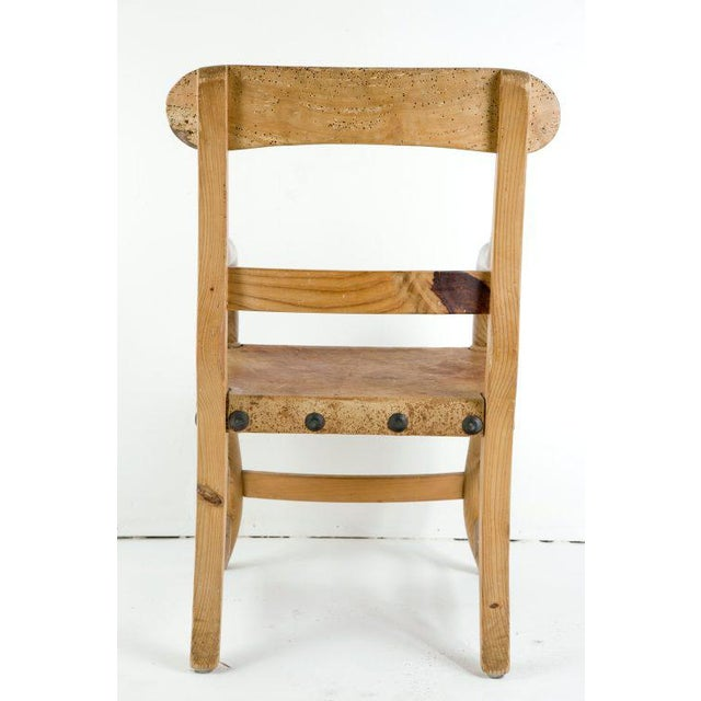 A wonderful rustic and sophisticated pine chair designed by Michael Taylor. This chair is photographed in several...
