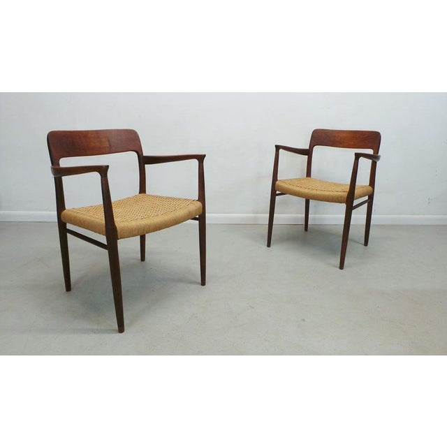 Stunning pair of mid century Danish modern teak framed, paper cord rope seat, #56 arm dining chairs by designer Niels...