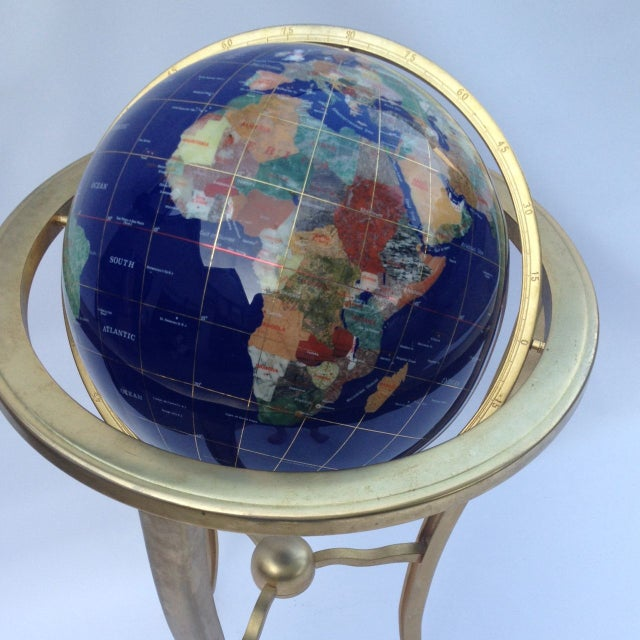 The world at your fingertips! This beautiful globe is meticulously pieced together from various precious stones and held...