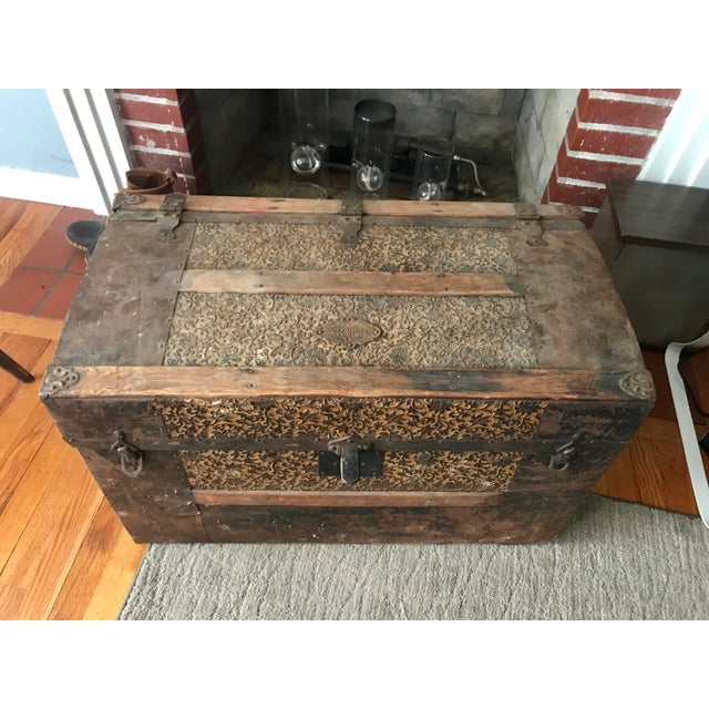 Very unique Trunk with ornate design work. Wood with metal sheath covering too. Trunk can be opened when pushed directly...