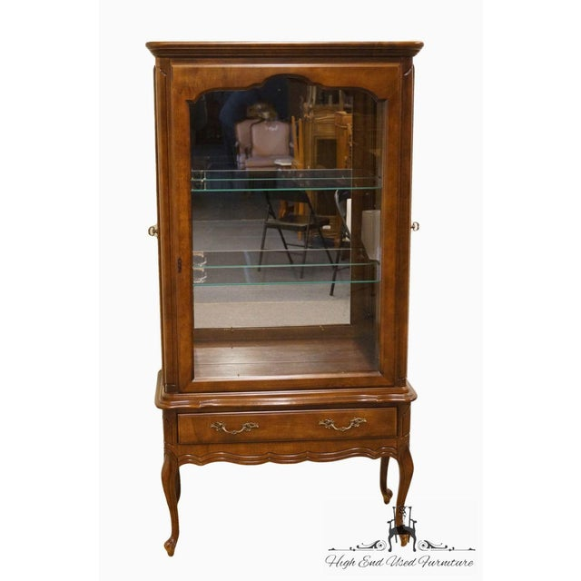 Hammary solid cherry Louis XVI Country French lighted curio display cabinet featuring a single drawer and two glass shelves.