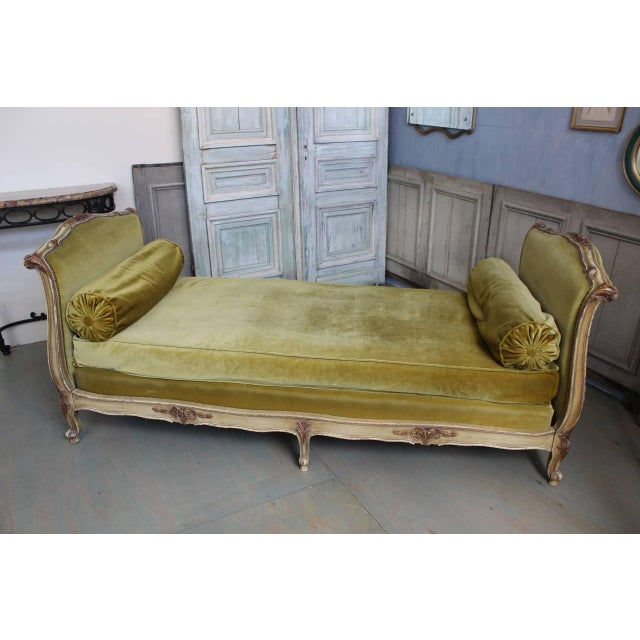 French 19th century Louis XV style settee with rounded back, original painted wood frame. Upholstered in a rich gold velvet.