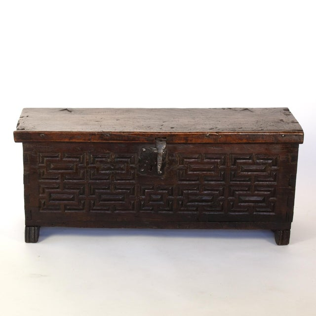 Baroque period Spanish walnut carved front coffer, geometric carved front panel, hinged lid with original iron hinges and...