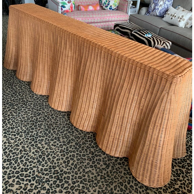 Vintage wicker draped console table. Made in the 2010s.